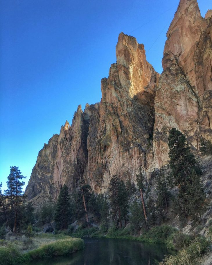 Colorful rock towering over Crooked River